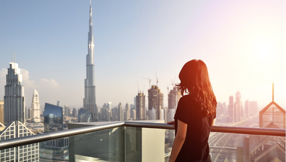 woman overlooking the cityscape of Dubai