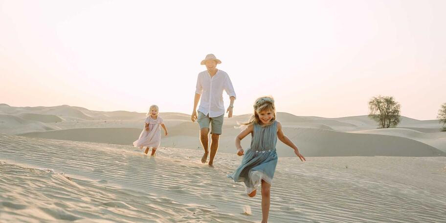 Family playing in the desert