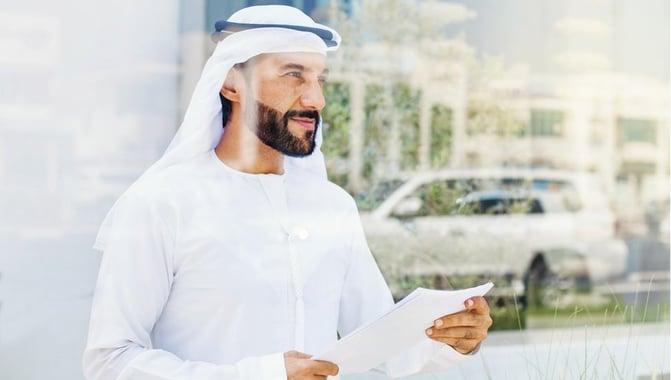 dubai-businessman-holding-regulations
