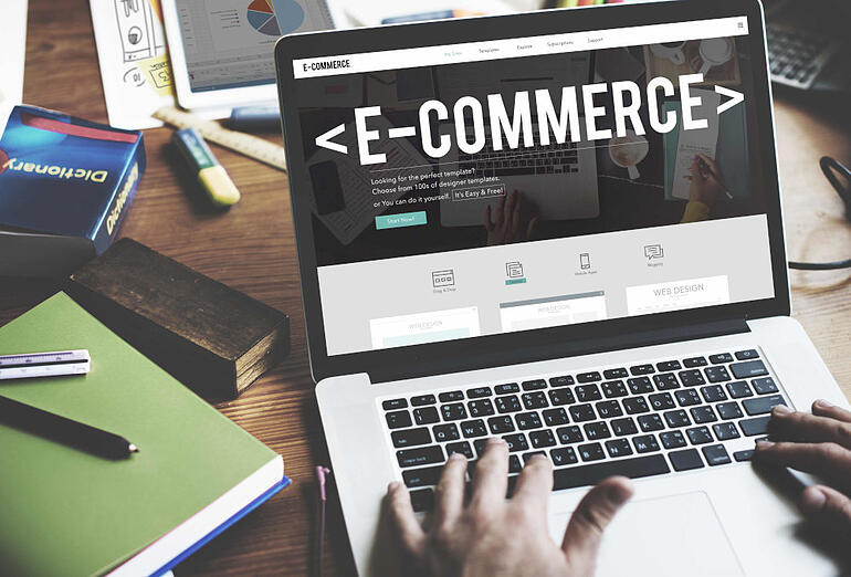 Laptop with the word 'E-Commerce' on the screen